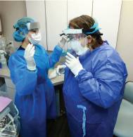 dentist with face shield